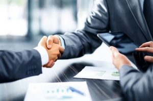 49572474 – business people shaking hands